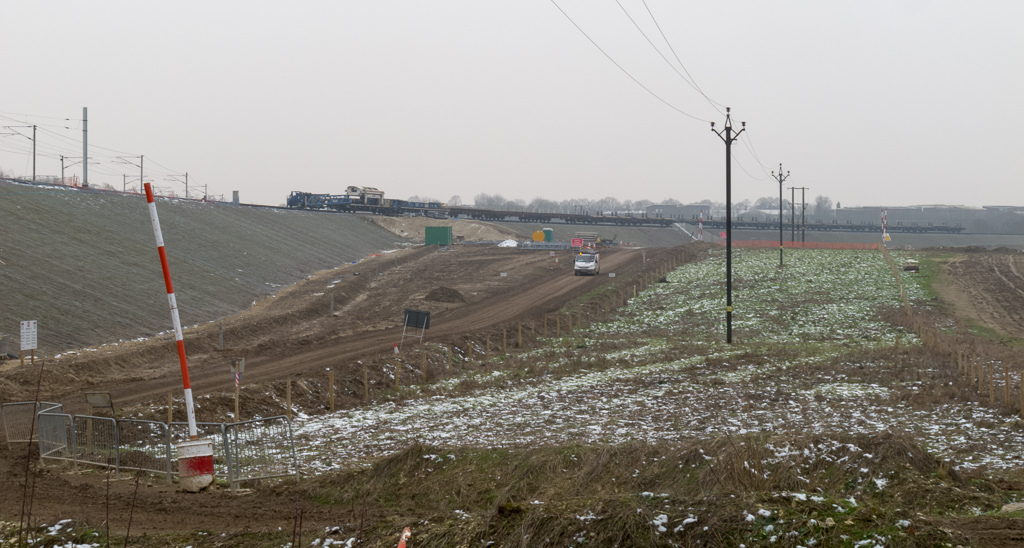 The tracklayer is standing near the country (Royston) end of the alignment with the existing route via Hitchin's Cambridge Junction converging on the left.