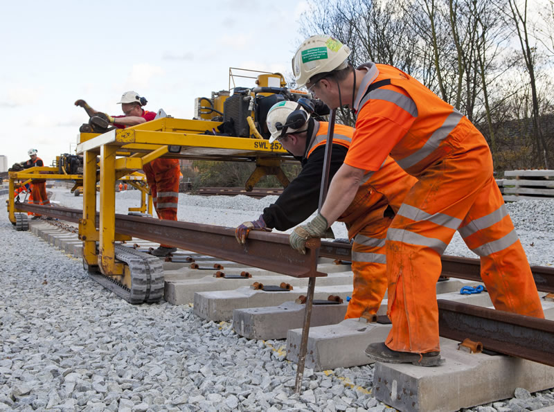 A Rail Being Lowered into Place