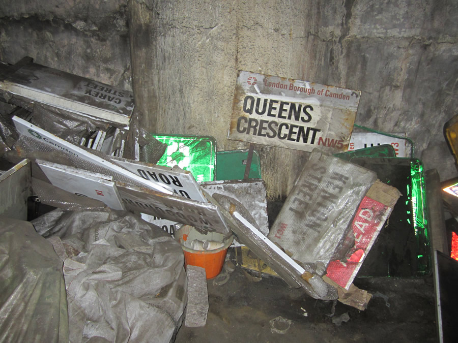 Street signs and other items clutter the tunnel