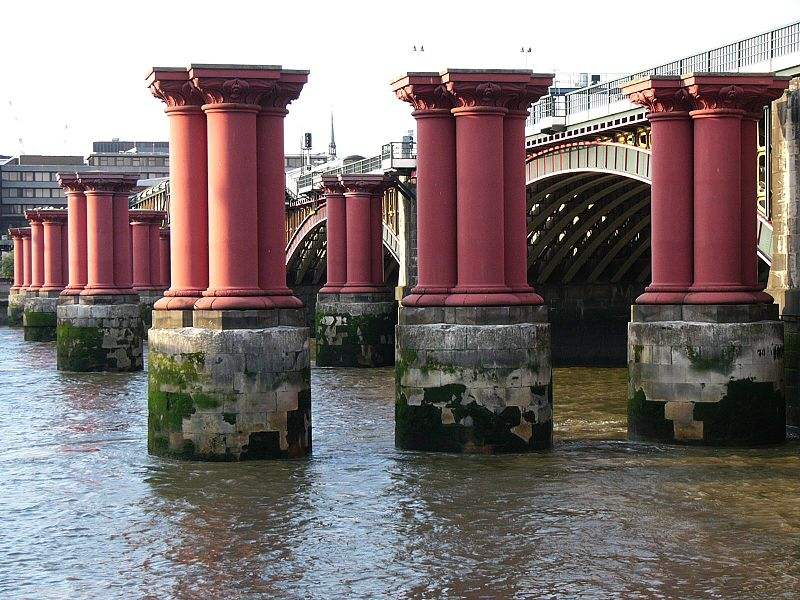 The original bridge piers, via Wikipedia