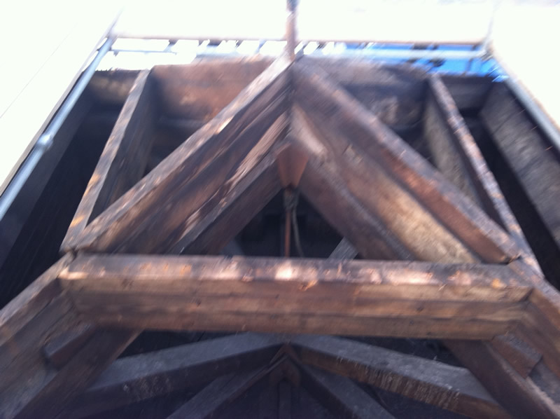 The wooden frame of the tower roof, exposed during restoration